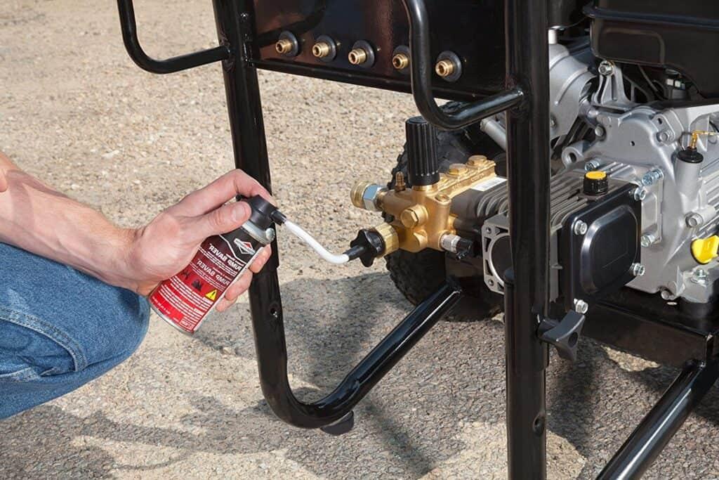 Jonathan applies a pump saver to his pressure washer.