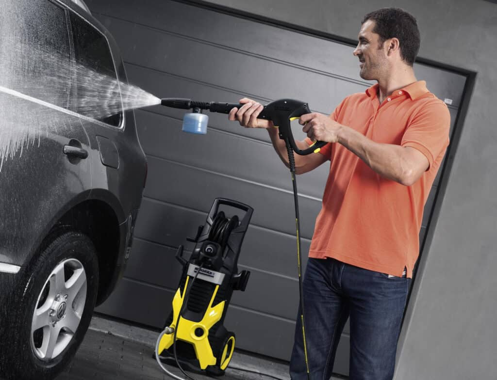 Rudolph washes the car with his new affordable pressure washer.